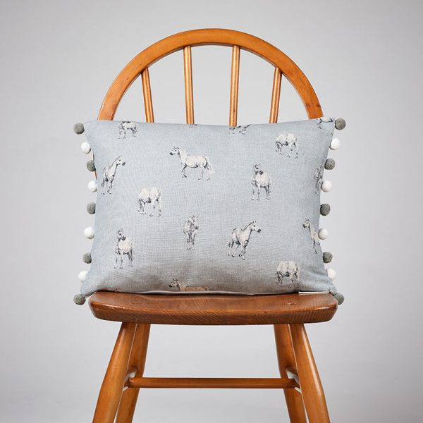 Milton and Manor Pony on Blue rectangle cushion with pompoms