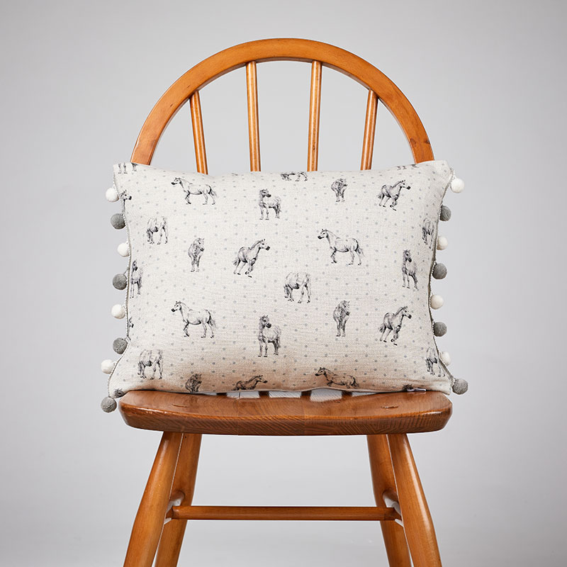 Milton and Manor Pony grey with Duck Egg Spots with pompoms rectangle cushion