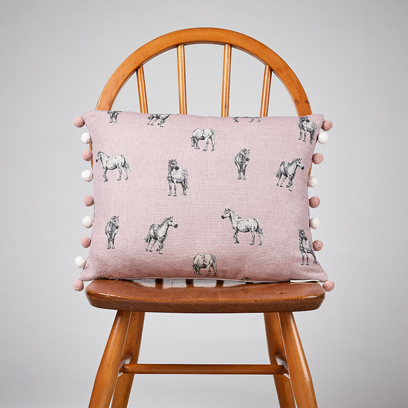 Milton and Manor Pony on Pink rectangle cushion with pompoms